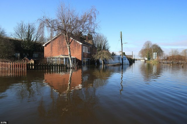 Floodwater surrounds a home in Snaith, East Yorkshire, with roads completely underwater in the area this morning