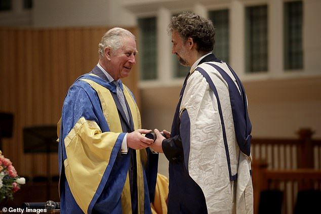 The Prince of Wales presents German operatic tenor Jonas Kaufmann with an honorary Doctor of Music award