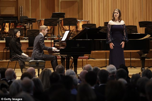 American student and mezzo-soprano Emily Sierra, from Chicago, performs on stage after being presented with the President's Award