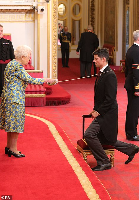 Her Majesty never usually wears gloves at the Palace events, shown here knighting Alastair Cook in February 2017 without her hands covered