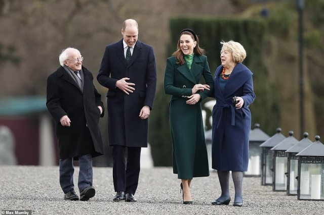 Kate joined arms with Sabina Higgins during the walk around the grounds, showing the warmth between the respective couples