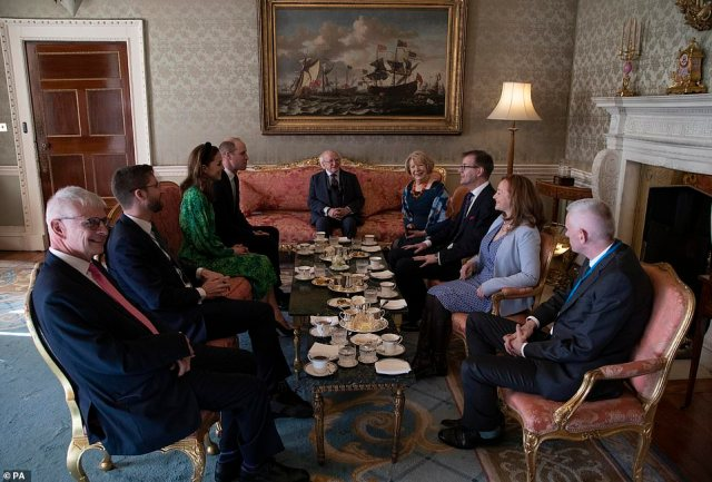 The couple's first official visit to the Republic of Ireland was a much more welcoming affair compared with Queen Elizabeth's visit to the same site in 2011, when Irish police were involved in scuffles with a small group of people protesting on the outskirts of the visit (they are pictured with the President of Ireland, Michael D. Higgins and his wife Sabina Coyne)