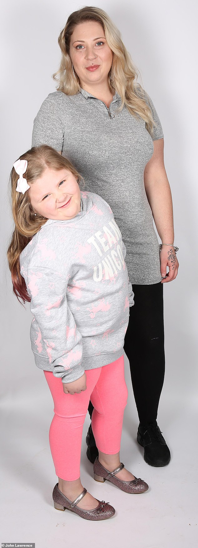 Five-year-old Liliane is dangerously overweight at 7 st. Her appetite is so voracious her mother Lana (pictured together) has caught her trying to eat raw sausages from the freezer