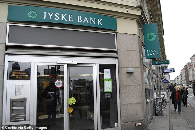 In August last year, the Danish Jyske Bank started paying borrowers a 0.5 per cent rate to take out a home loan with them. Pictured is a Jyske Bank branch in Copenhagen
