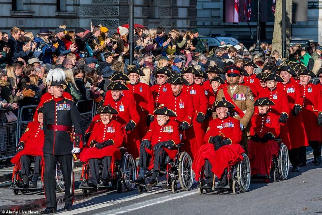 Older people could be advised to stay away from mass gatherings, potentially putting events like the VE Day commemorations in jeopardy from May 8-10. Pictured:Chelsea pensioners at the Remembrance Sunday parade last year