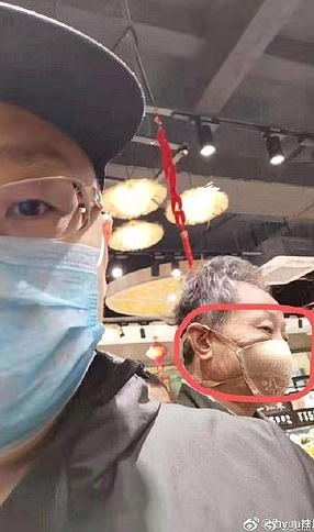A man with a bra on his face