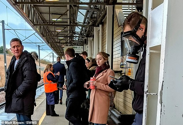 Photos, circulated on social media, show people coming up with creative ways of covering their nose and mouths in a bid to avoid contamination. A commuter wearing a gas mask attracted bemused looks while waiting on the platform at Milton Keynes Central station