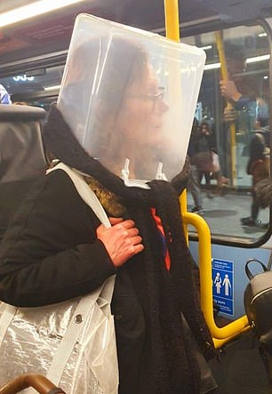 A woman travelled on the tube in London with a large plastic container over her head today