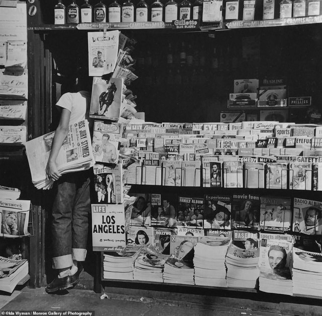 A young boy works a newsstand in Los Angeles, 1950. Ida Wyman's most memorable work stems from the six years between 1945 - 1951. By then she had married Simon Nathan, a fellow photographer at Acme and decided to become a homemaker when their first child, David was born that same year.