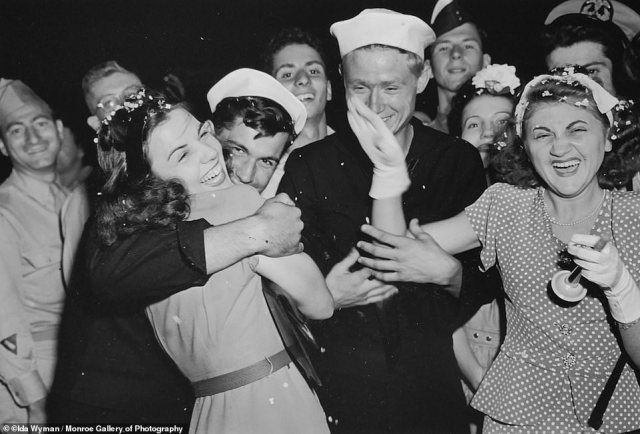 Wyman captured a group of enthusiastic revelers celebrating Japan's unconditional surrender which put an end to WWII on August 15, 1945. The image of a sailor and smiling woman in a tight embrace 'serves as a sort of bookend to Alfred Eisenstaedt's better-known photograph, taken that day in Times Square, of a sailor kissing a nurse,' said the New York Times.