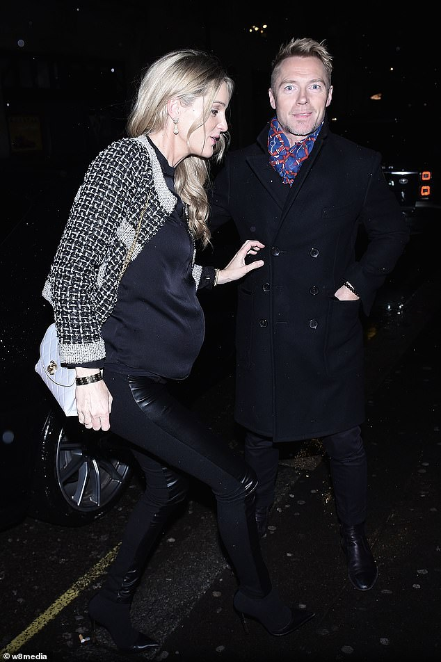 Bumping along nicely: Storm Keating showed off her growing baby bump in a black top and leggings as she celebrated husband Ronan's birthday in London on Thursday