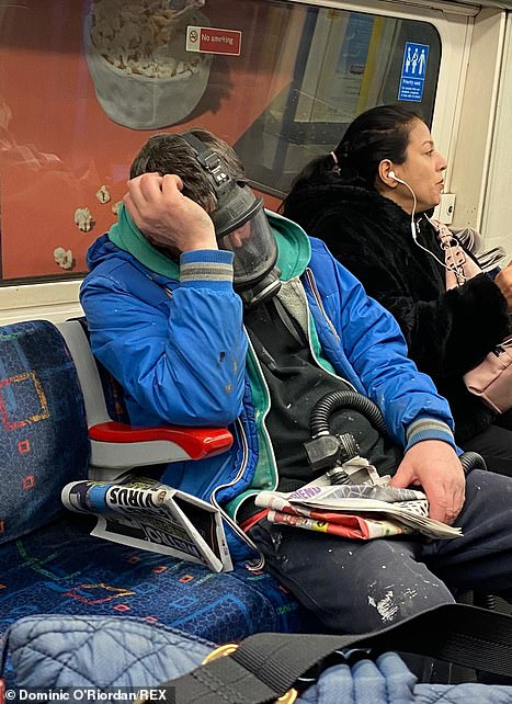 A man on the underground wearing a gas mask coronavirus outbreak on Friday