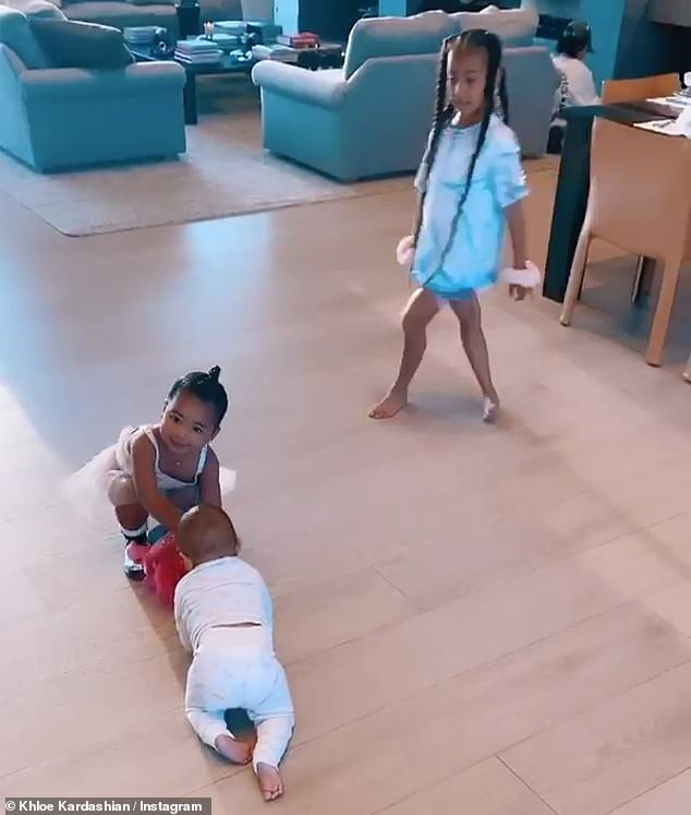 Family get-together: Khloé Kardashian caught some adorable video of her daughter True Thompson playing with her cousins North, Saint, Chicago and Psalm West on Friday
