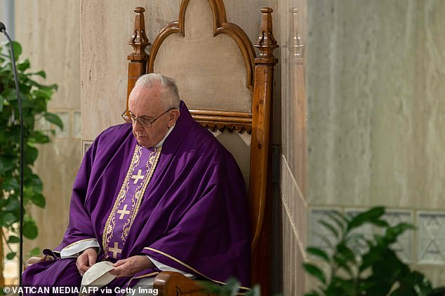Francis sits during Mass this morning in the Vatican, a city-state surrounded entirely by Italy that has imposed new and severe quarantine measures