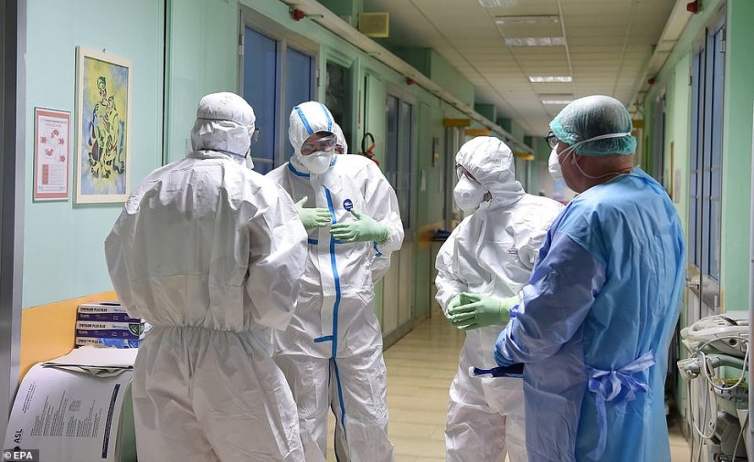 Health workers wearing protective suits, masks and gloves are pictured at work in the Amedeo di Savoia hospital in Turin