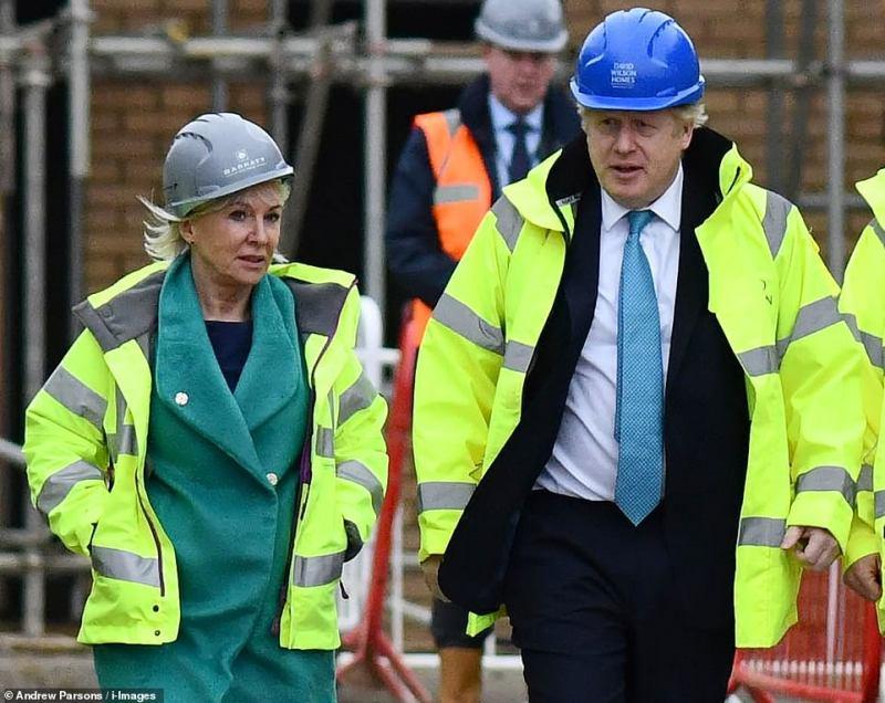 Prime Minister Boris Johnson withNadine Dorries bricklaying inBedford last November