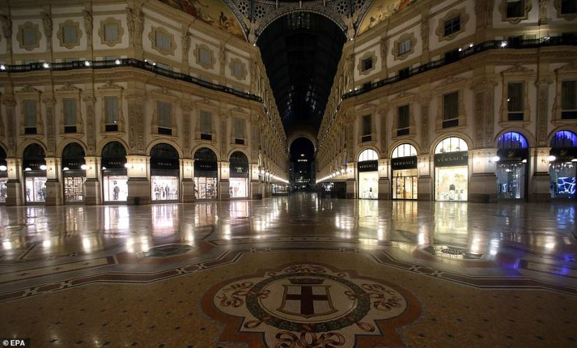 An empty shopping arcade was visited in Milan last night, with tourists staying away because of the coronavirus crisis