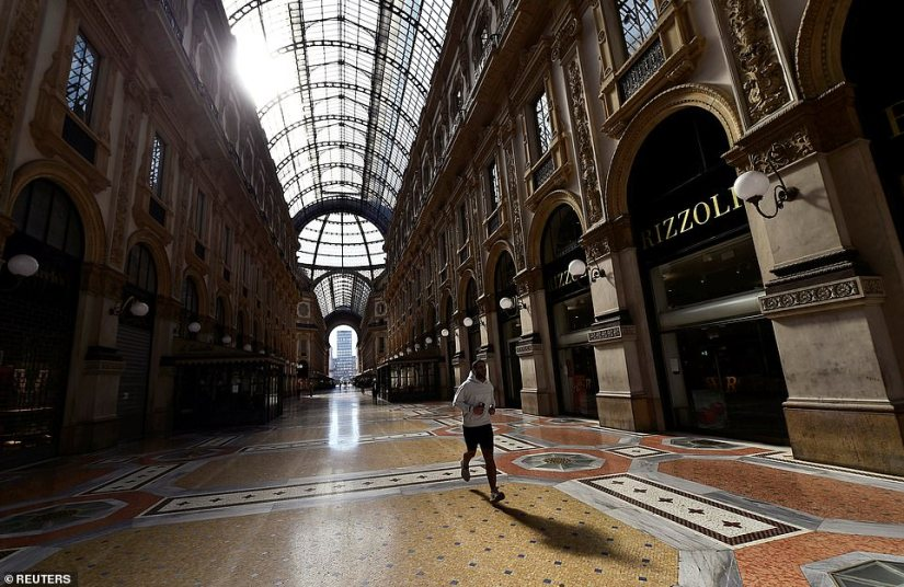 A jogger makes his way through the Galleria Vittorio Emanuele II today, the centerpiece of Milan's famous shopping district