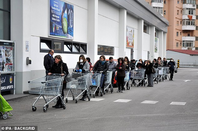 Social distancing measures – attempting to keep people between three and six feet apart from one another – have already been brought in in Italy (pictured, a queue outside a supermarket in Palermo) and could soon be on the streets of Britain
