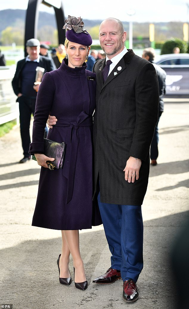 Zara and Mike Tindall beamed and stood with their arms wrapped around each other as they posed for photos ahead of the Cheltenham Gold Cup this afternoon