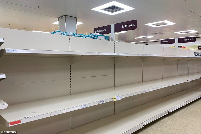British Retail Consortium members sent a joint letter to consumers asking everyone to work together to ensure there is enough food for the country. Pictured: Empty shelves in London