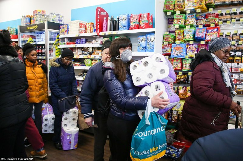 Shoppers panic-buying toilet rolls in Savers, north London, as the number of confirmed UK Covid-19 cases surpassed 1,110