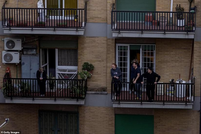 Residents on the balconies sing