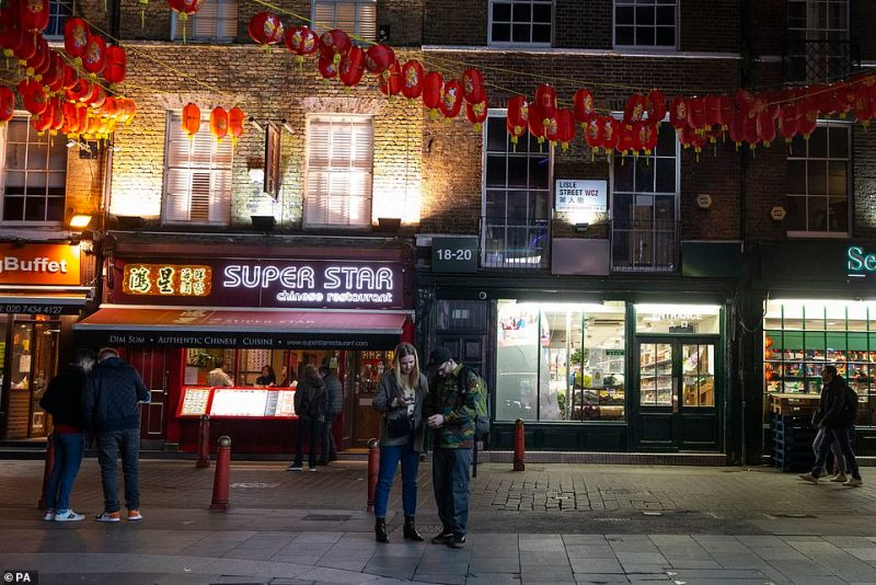 The government's top scientist warned that up to 10,000 people in the UK are already infected. Pictured: A nearly empty Chinatown, London, Saturday night