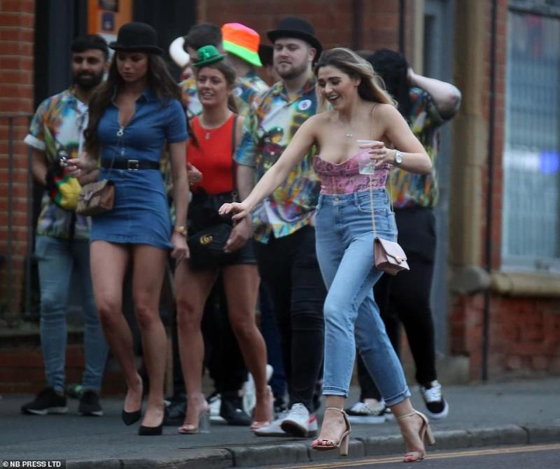 Out on the town: Students wore elaborate costumes and outfits as they stepped out to visit multiple bars in one evening in Leeds on Saturday
