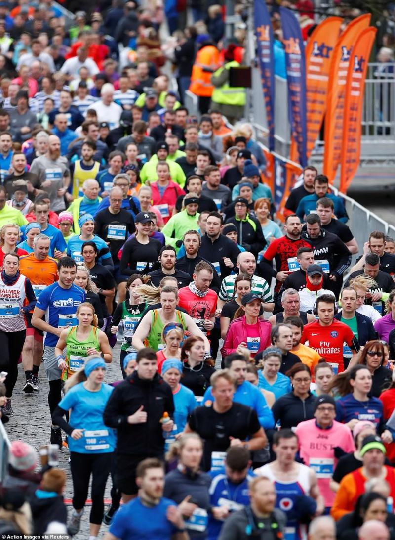 Runners past each other in close proximity as they compete in the Liverpool Half Marathon on Sunday