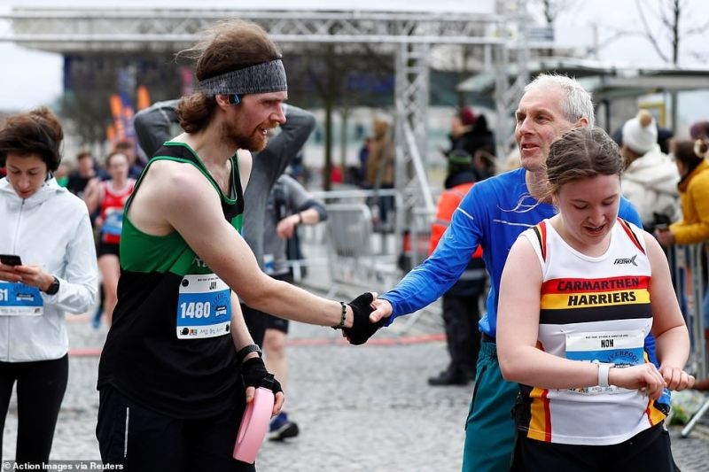 Runners shake hands after the race. The event went ahead as planned today despite the last 24 hours seeing the UK's death toll double