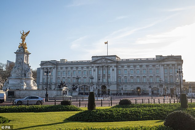 The Royal Standard flies over the monarch's official residence in central London, Buckingham Palace (pictured) - despite the ongoing Covid-19 crisis