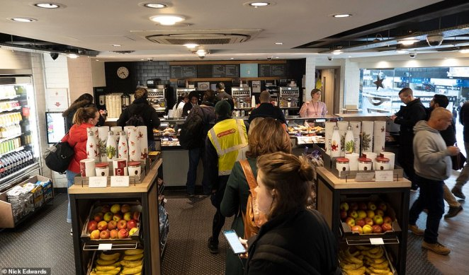 A Pret cafe at London Waterloo station had dozens of customers queuing for coffee this morning despite fewer commuters