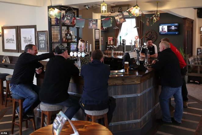 A view at lunchtime in The Rocket pub at Rainhill in Merseyside today, the day after Prime Minister Boris Johnson called on people to stay away from pubs, clubs and theatres, work from home if possible and avoid all non-essential contact