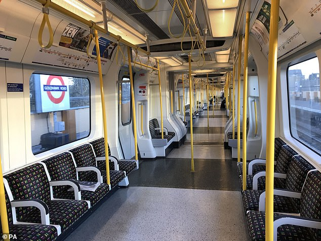 A sparsely-filled carriage on an Underground train at Goldhawk Road in West London today