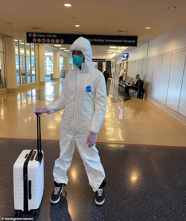 Dr Varshavski says the only people who should be wearing masks are those who are sick and doctors treating sick patients. Pictured: Naomi Campbell wearing a hazmat suit on a flight