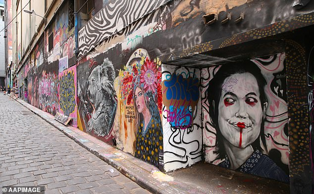 Usually full of tourists coming to admire street art, Melbourne's Hosier Lane sat empty on Wednesday afternoon (pictured)
