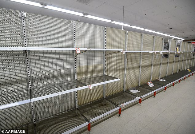 Totally bare: The toilet paper aisle at a Coles supermarket last Friday