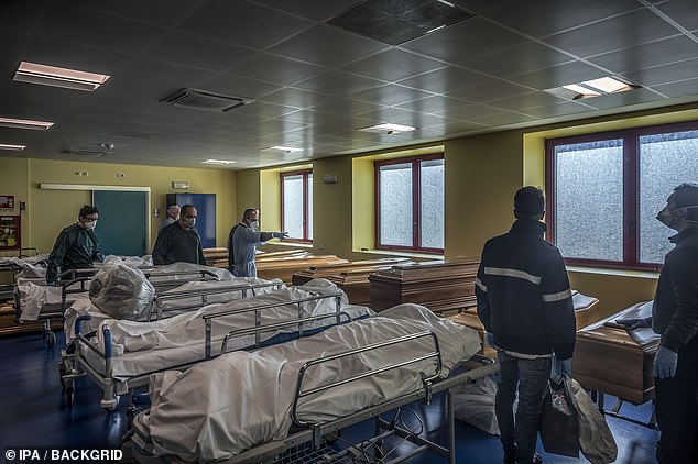 The coronavirus kills people by triggering pneumonia, an infection which essentially floods the lungs, and organ failure. Pictured are dead patients at an Italian hospital