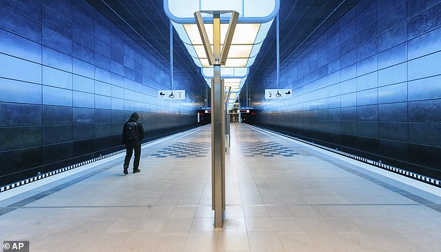 A single man walks on a platform of the subway station Hafencity University in Hamburg, Germany