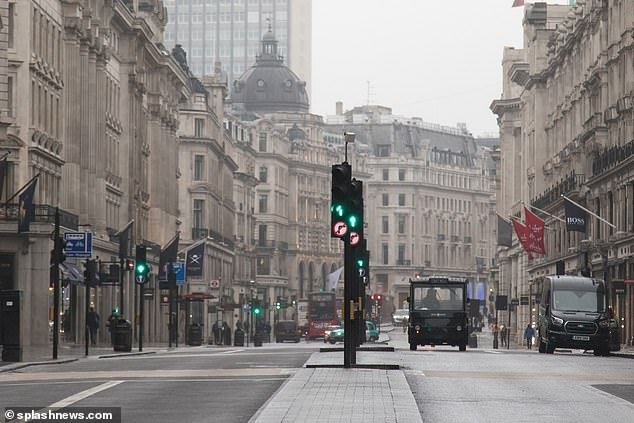 The UK's coronavirus outbreak has spiralled out of control and London is at the centre of an epidemic of thousands or tens of thousands of infected people. Around 900 people in the city have been officially diagnosed (Pictured, central London was bereft of traffic this morning)