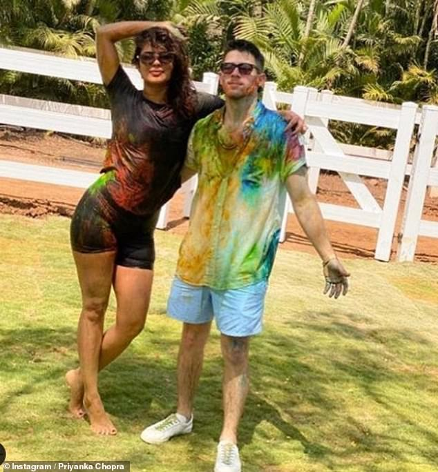 Mr and Mrs: Priyanka explained that she and her husband Nick had self-isolated together as a precaution (pictured during last week's Holi celebrations)