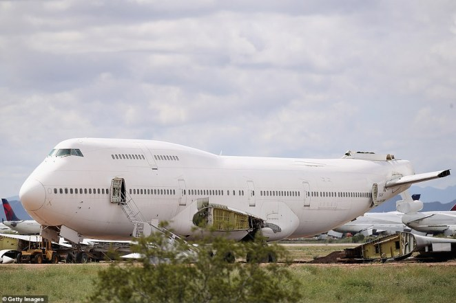 A decommissioned 747 is seen among various smaller planes at the Pinal Airpark, which is mainly used as a 'boneyard' for commercial planes