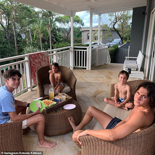 'Practicing for lockdown in style': Antonia shared this photo of her sons Hamish, James, Nicholas and Alexander practicing social distancing last month