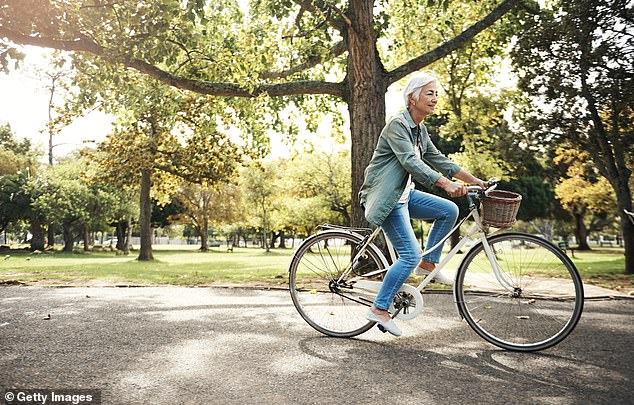 Going for a walk or cycling in the fresh air, ideally near the ocean or trees, will increase the production of dopamine - the 'feel good' chemical - in the brain (stock image)