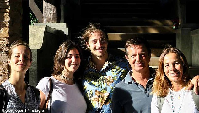 Giorgio Gori (right, with his partner) is bringing his two daughters (left) home to the worst-hit town in Italy from the UK because he believes they will be safer there after the British government failed to act quickly enough over coronavirus