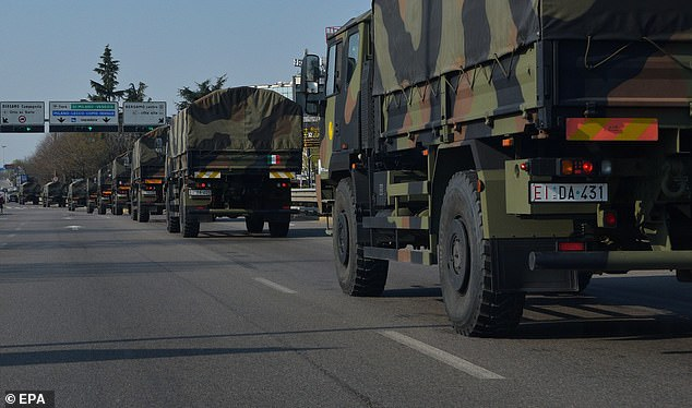 Military trucks carrying the coffins of COVID-19 Coronavirus victims are seen outside the Bergamo's cemetery