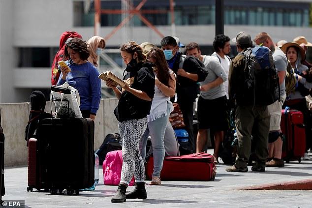 Travellers wait for a flight at La Aurora International Airport inGuatemala City, Guatemala