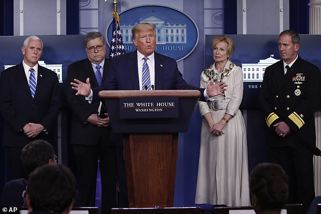 President Donald Trump answers reporters' questions as he talks about the coronavirus in Washington on Monday