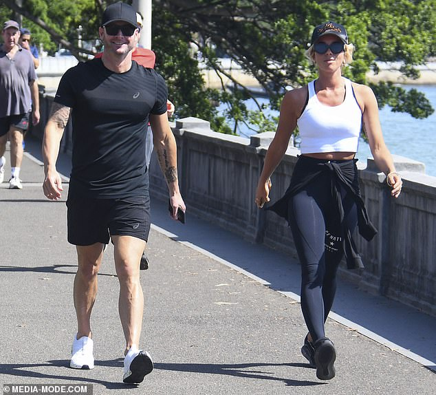 Athletic: Pip, 40, flaunted her toned figure in skintight leggings and a white crop top, and tied a black hoodie around her waist